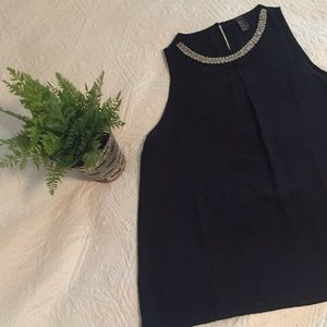 Black shirt with neckline embellishment